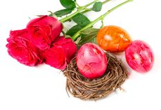 Easter eggs and roses stock photo