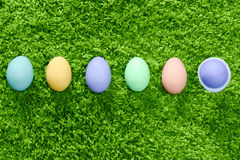Easter eggs in a row. Colored easter eggs in a row son green background Royalty Free Stock Photos