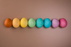 Easter eggs row on beige background Stock Photography