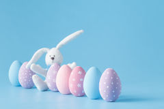 Easter eggs in a row, on blue background Royalty Free Stock Image