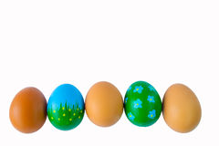 Easter eggs in a row. Easter eggs in a roEaster eggs in a row on a white backgroundw Stock Photography