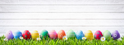 Easter Eggs In A Row. And White Wooden Background
