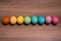Easter eggs row on wooden background Stock Photography