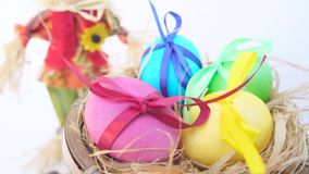 Easter eggs in a rustic cart, a straw man stock video