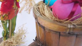 Easter eggs in a rustic cart, a straw man