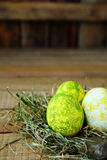 Easter eggs in rustic Stock Photography