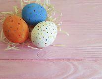 Easter eggs rustic in straw,background wooden pink space springtime festive april, card. Easter eggs in straw wooden pink april card springtime festive space Stock Photography