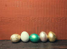 Easter eggs on rustic wooden table. Royalty Free Stock Image