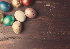 Easter eggs on rustic wooden table. Stock Photo