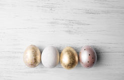 Easter eggs on rustic wooden table. Stock Images