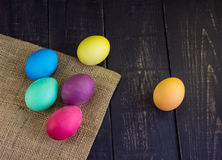 Easter eggs with sack on wooden desks Royalty Free Stock Image