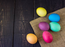 Easter eggs with sack on wooden table Stock Images