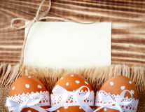 Easter eggs on sacking. Easter eggs on burlap and wooden boards Royalty Free Stock Photo