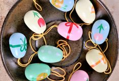 Easter eggs on a saucer, colorful scene. Decoration for Easter branches Stock Photo