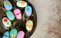 Easter eggs on a saucer, colorful scene. Decoration for Easter branches Royalty Free Stock Image