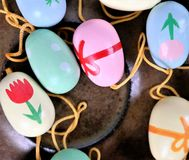 Easter eggs on a saucer, colorful scene,. Decoration for Easter branches Stock Photos