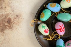 Easter eggs on a saucer, colorful scene. And rusty background Stock Photos
