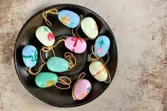 Easter eggs on a saucer, colorful scene. And rusty background Royalty Free Stock Photos