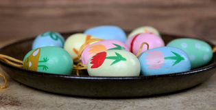 Easter eggs on a saucer, decoration for Easter branches. Easter eggs on a saucer, colorful scene, decoration for Easter branches Royalty Free Stock Photos