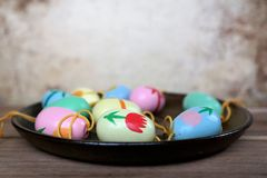 Easter eggs on a saucer, decoration for Easter branches. Easter eggs on a saucer, colorful scene, decoration for Easter branches Royalty Free Stock Photo