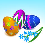 Easter eggs and scillia flower Stock Images