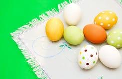 Easter eggs on serviette Stock Photos