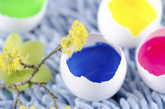Easter eggs shells filled with paints Stock Photos