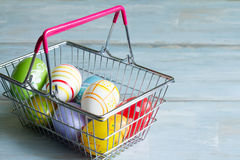 easter eggs in a shopping basket Royalty Free Stock Images