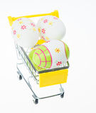Easter eggs in shopping cart Royalty Free Stock Images