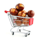 Easter eggs in shopping trolley. Isolated on white background Royalty Free Stock Images