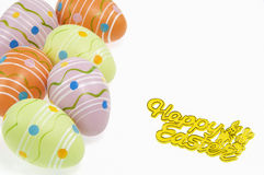 Easter eggs and sign on white background Stock Photo