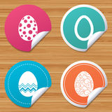 Easter eggs signs. Circles and floral patterns. Round stickers or website banners. Easter eggs icons. Circles and floral patterns symbols. Tradition Pasch signs Stock Images
