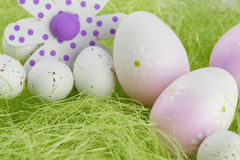 Easter Eggs sitting on grass and Flower. Easter Eggs sitting on green grass and Flower Royalty Free Stock Images