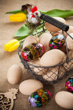 Easter eggs in a small basket Stock Photos