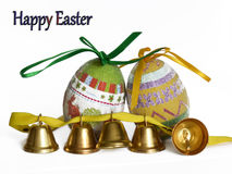 Easter eggs and small bells Royalty Free Stock Image