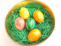 Easter Eggs. Some colorful Easter Eggs in a basket royalty free stock photo