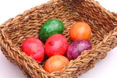Easter Eggs. Some colourful easter egges in a basket royalty free stock photos
