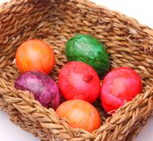 Easter Eggs. Some colourful easter egges in a basket royalty free stock photo
