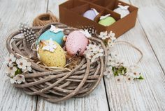 Easter eggs and spring  blossom. On a old wooden background Royalty Free Stock Image
