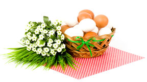 Easter eggs and spring flowers Stock Photos