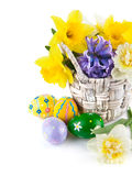 Easter eggs with spring flowers in basket Royalty Free Stock Photography