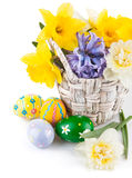 Easter eggs with spring flowers in basket Stock Image