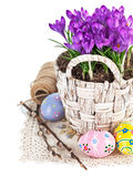 Easter eggs with spring flowers in basket Stock Photo