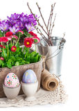 Easter eggs with spring flowers in basket Stock Photos