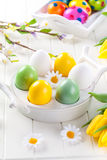 Easter eggs with spring flowers. Decorating table Royalty Free Stock Photography