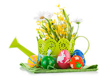 Easter eggs with spring flowers Stock Photos