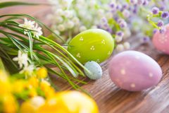 Easter eggs and spring flowers on rustic wooden background Stock Images