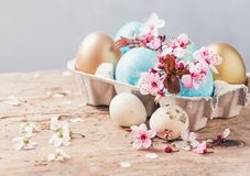 Easter eggs and spring flowers on rustic wooden background.Easter holiday card copy space. stock photo