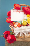 Easter eggs and  spring flowers tilips, postcard Stock Photography