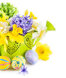 Easter eggs with spring flowers in watering can Stock Images